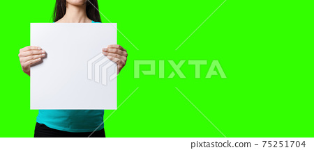 Beautiful Woman holding blank signboard on green screen background. suitable your element project. added copy space for text. 75251704
