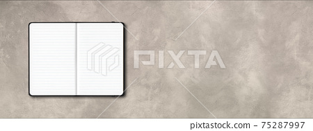 Black open lined notebook isolated on concrete background. Horizontal banner 75287997