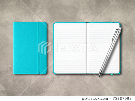 Aqua blue closed and open lined notebooks with a pen on concrete background 75287998
