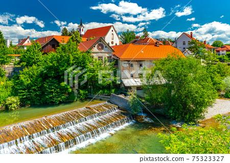 A small waterfall in the ancient Slovenian town Skofja Loka 75323327