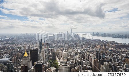 Manhattan skyscrapers in a haze of clouds. Top view of the New York business district 75327679