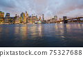 Beautiful Brooklyn Bridge on the background of the night New York cityscape 75327688