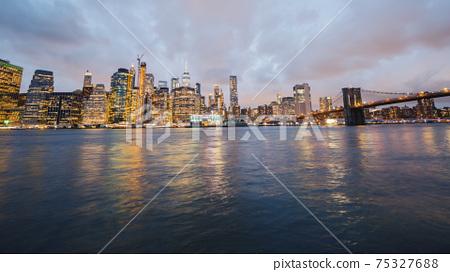 Beautiful Brooklyn Bridge on the background of the night New York cityscape 75327688