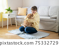 Pretty young woman with cute cat at home 75332729