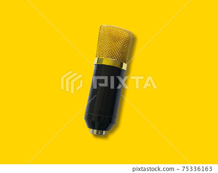 Gold condenser microphone isolated on yellow background 75336163
