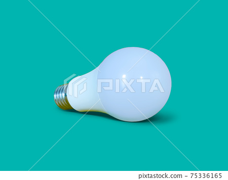 White LED light bulb isolated on turquoise color background.  Lay down position. 75336165