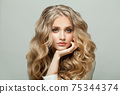 Attractive blonde woman with long healthy hair on white background 75344374