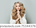 Lovely blonde woman with long healthy hairstyle on white background 75344376