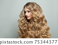 Smiling woman fashion model with long healthy hairstyle on white background 75344377