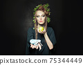 Woman with used face mask.  Environment protection and waste recycling concept 75344449