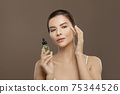 Healthy woman spa model with cosmetic oil 75344526