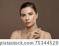 Healthy woman spa model with cosmetic oil 75344529