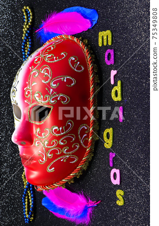 Mardi Gras Full Mask With Feathers And Bead Strings 75349808