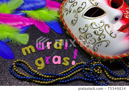 Mardi Gras Text And Beads With Mask And Feathers 75349814