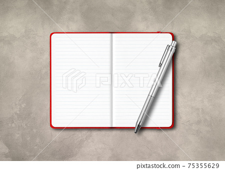 Red open lined notebook with a pen isolated on concrete background 75355629
