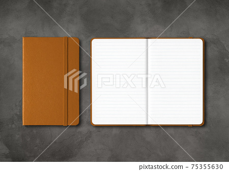 Leather closed and open lined notebooks on dark concrete background 75355630