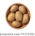Fresh raw potatoes in a wooden bowl  isolated on a white background. Top view. 75375491