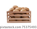 fresh raw potatoes in a wooden box isolated on white background. 75375493