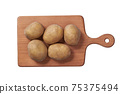 fresh potatoes on a cutting board isolated on white background. Top view. 75375494