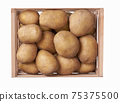 fresh raw potatoes in a wooden box isolated on white background. Top view. 75375500