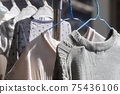 Laundry dried in a sunny place 75436106