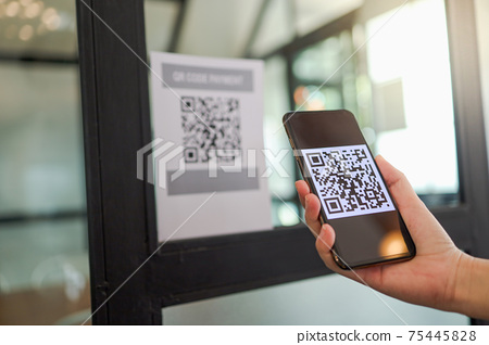 Qr code payment. E wallet. Man scanning tag accepted generate digital pay without money.scanning QR code online shopping cashless payment and verification.technology concept 75445828