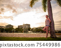 Half-woman standing in the evening lagoon 75449986