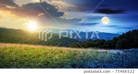 day and night time change concept above summer mountain landscape. beautiful scenery with sun and moon. beech forest and grassy alpine meadows on the hills. clouds on the gorgeous sky 75466522