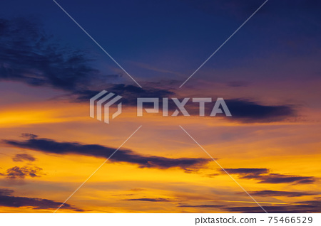 dark clouds on the glowing sky at sunset. dramatic nature scenery on the windy weather in evening 75466529