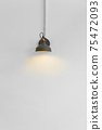 orange light lamp on white wall background 75472093