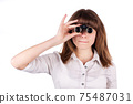 Portrait of a beautiful young woman with binoculars. Isolated 75487031