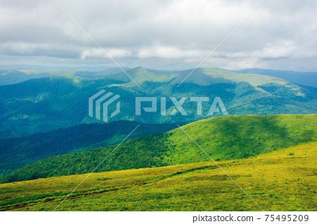 path through mountain meadow. beautiful carpathian landscape in summertime. clouds on the sky above the distant ridge. windy weather 75495209