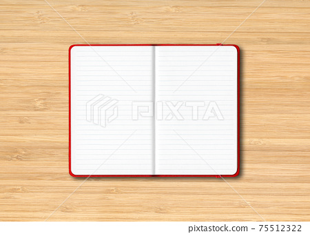 Red open lined notebook isolated on wooden background 75512322