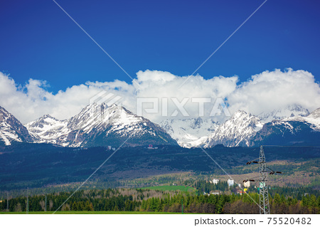 high tatra mountain ridge in springtime. cloud above the snow capped rocky peaks. beautiful sunny weather. wonderful nature scenery 75520482