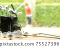 Golf balls, golf equipment and golf club on the table on driving range with the golfer in background 75527396