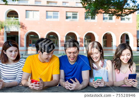 young students use smartphone 75528946