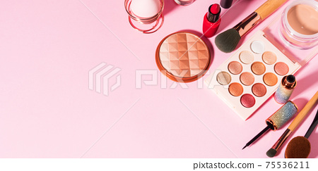 Different make up beauty cosmetics products on pink 75536211
