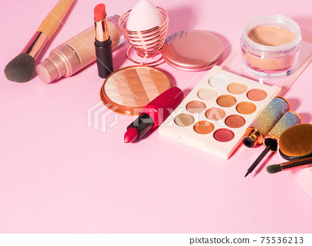 Different make up beauty cosmetics products on pink 75536213