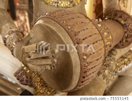 Statue of Imp God in Gangaramaya Temple in Colombo Sri Lanka - Playing Drum 75555145
