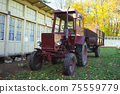 Vintage tractor at home in autumn 75559779