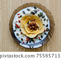 Breakfast, healthy food, porridge with nuts, seeds and dried fruits in a plate. 75565713