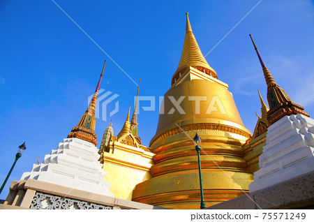 Golden pagoda at Temple of the Emerald Buddha in Bangkok, Thailand.  75571249