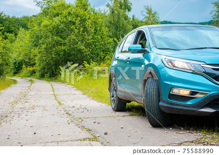 suv on the concrete roadside in the forest. travel countryside concept. beautiful nature scenery in summer 75588990