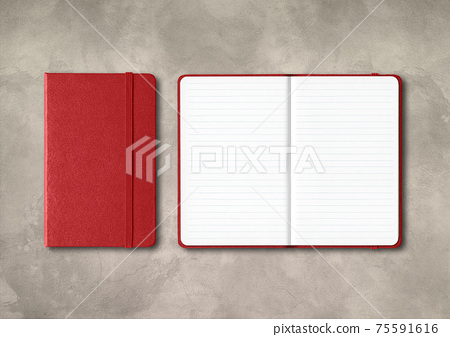 Dark red closed and open lined notebooks on concrete background 75591616