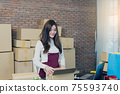 Small business startup entrepreneur SME or freelance woman working with boxes at home or office. handling delivery packages. Online marketing packaging box and delivery. Business Logistic and Delivery 75593740