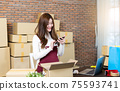 Small business startup entrepreneur SME or freelance woman working with boxes at home or office. handling delivery packages. Online marketing packaging box and delivery. Business Logistic and Delivery 75593741