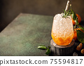Fresh cocktail with crushed ice, rosemary and tangerines 75594817