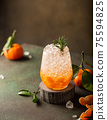 Fresh cocktail with crushed ice, rosemary and tangerines 75594825