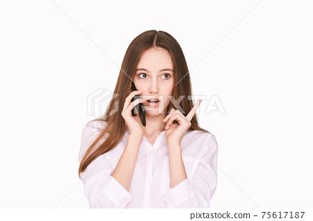 Talking smartphone. Calling friends. Businesswoman home office. Look side 75617187