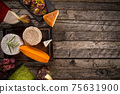 Natural organic cheeses on wooden background. 75631900